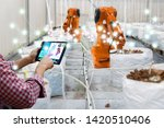 smart robotic farmers harvest... | Shutterstock . vector #1420510406