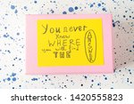 Small photo of Pink box with concept inspirational quote card on yellow background. You never know where you will find the answer. Self motivation.