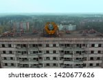 Pripyat aerial panorama cityview over the sign of USSR on the roof of building. Drone flies over the deserted abandoned city of Pripyat, Ukraine. Exclusion zone near the Chernobyl nuclear power plant.