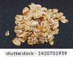 slight oat flakes on a black...   Shutterstock . vector #1420701959