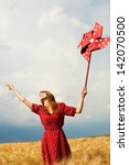 redhead girl with toy wind... | Shutterstock . vector #142070500