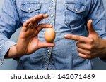 Man Pointing At Egg