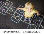 Little Boy On Hopscotch Drawn...