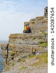 Small photo of Tourists in Dun Aengus, an ancient fort on Inishmore, Aran Islands, Ireland