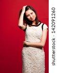 portrait of woman in dress | Shutterstock . vector #142091260