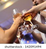 glasses with champagne in hand. | Shutterstock . vector #142091494