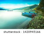 Blue Sky And Calm Lake With...