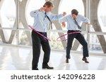 businessmen taking a play break ... | Shutterstock . vector #142096228