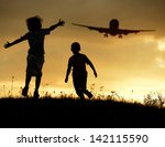 Active two kids jumping while the airplane landing in air - stock photo