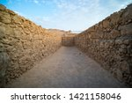Small photo of View to the old stone blind alley. Architecture of ancient civilization. Masada paths and passages, Israel. Labyrinth dead-end. Concept of deadlock. Be at deadlock. Searching for way out in labirinth.
