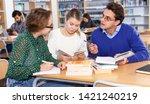 male tutor helping girls... | Shutterstock . vector #1421240219
