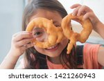 cute little girl with onion ring
