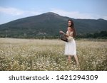 beautiful woman with long...   Shutterstock . vector #1421294309