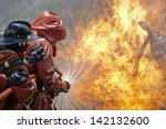 Firefighter Fighting A Fire...