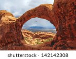 bird flying through the top o... | Shutterstock . vector #142142308