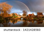 village river houses rainbow... | Shutterstock . vector #1421428583