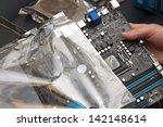 unpacking the motherboard | Shutterstock . vector #142148614