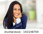 smiling young indian woman in... | Shutterstock . vector #142148704