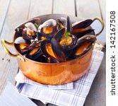 copper pot of gourmet mussels...   Shutterstock . vector #142167508