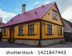 old wooden yellow building with ... | Shutterstock . vector #1421847443