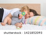 young exhausted taking a nap... | Shutterstock . vector #1421852093