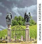 Gargoyle Statues On Iron Gated...