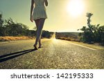 young woman walking barefoot on ... | Shutterstock . vector #142195333