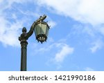 vintage black lamppost against... | Shutterstock . vector #1421990186