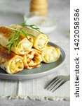 tasty stuffed pancakes crepes...   Shutterstock . vector #1422058586