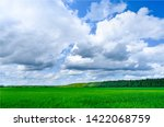 green field and blue sky with... | Shutterstock . vector #1422068759