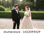 newlyweds are walking in the... | Shutterstock . vector #1422095429