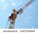 Small photo of Crane. Construction crane. Huge crane against blue sky. Self-erection cranr. Tower crane.