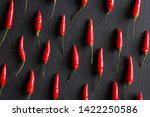 red hot chili peppers on black... | Shutterstock . vector #1422250586
