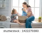 beautiful young woman and child ... | Shutterstock . vector #1422270383