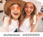two young smiling hipster blond ... | Shutterstock . vector #1422543353