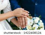 wedding rings on the hands of... | Shutterstock . vector #1422608126