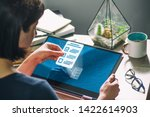 woman with laptop on her desk.... | Shutterstock . vector #1422614903