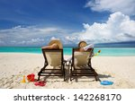 couple on a tropical beach at... | Shutterstock . vector #142268170