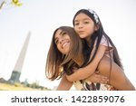 mother playing with daughter latina little girl playing happy latinas