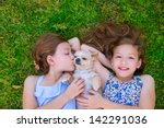 twin sisters playing with... | Shutterstock . vector #142291036
