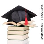 grad hat with books isolated on ... | Shutterstock . vector #142293346