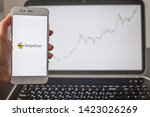 Small photo of SAINT PETERSBURG, RUSSIA - MAY 14, 2019: logo of Russian company VimpelCom Beeline on the smartphone screen on the background of stock charts. Investments in Russian business, illustrative editorial