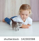 Stock photo funny little girl playing with kitten 142303588