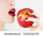 eating an apple | Shutterstock . vector #142310170