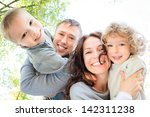 low angle view of happy family... | Shutterstock . vector #142311238