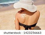 beauty woman apply sun cream...   Shutterstock . vector #1423256663