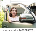 asian woman holding money while ... | Shutterstock . vector #1423273673