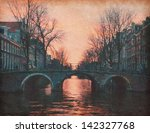 Stock photo evening in amsterdam netherlands photo in retro style paper texture 142327768