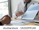 managers and accountants have... | Shutterstock . vector #1423299140