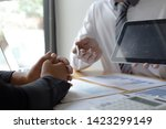 managers and accountants have... | Shutterstock . vector #1423299149